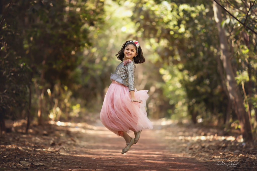 jumping girl in the forest